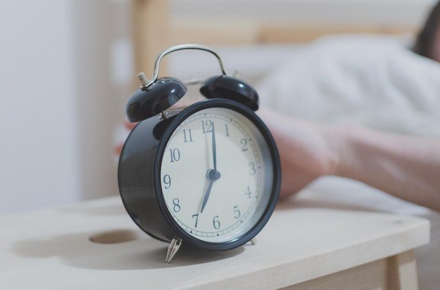 Alarm clock to symbolize waking up early to balance life as a stay at home mom and a freelancer.