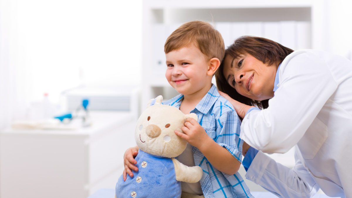 Senior female doctor examining little child boy  Article: Pay Less on Medical Care for Your Child